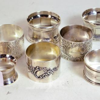 7 Serviettenringe, teils Silber