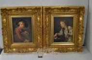 2 Portrait-Drucke im breiten goldf. Rahmen