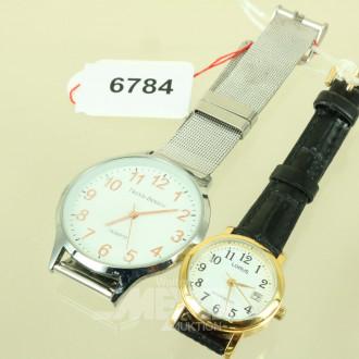 Damen- und 1 Herrenarmbanduhr