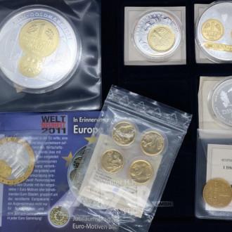 Münz-Kassette u. 10 Münzen