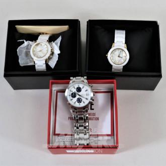 3 versch. Armbanduhren, ungetragen,: